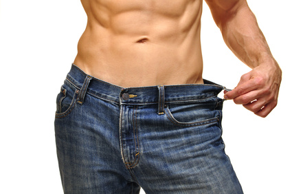 Closeup of sexy male abs and waist in jeans on white background